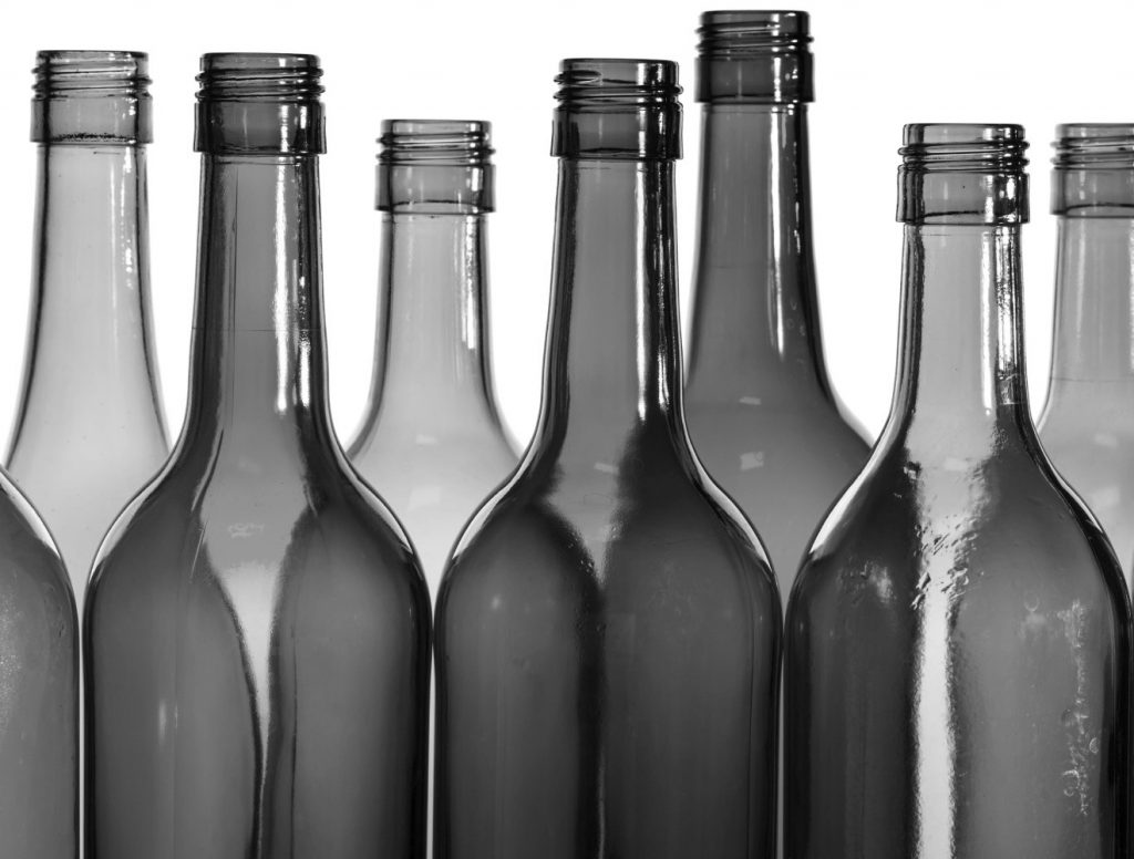 Empty glass wine bottles, washed and ready for recycling.; Shutterstock ID 148576436; PO: aol; Job: production; Client: drone